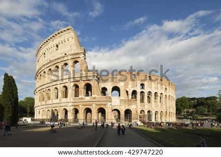 ROME - ITALY, MAY 24, 2016: Tourists visiting the Colosseum on may 10, 2012. The Colosseum is an iconic symbol of Imperial Rome. It is one of Rome's most popular tourist attractions in Rome. - stock photo