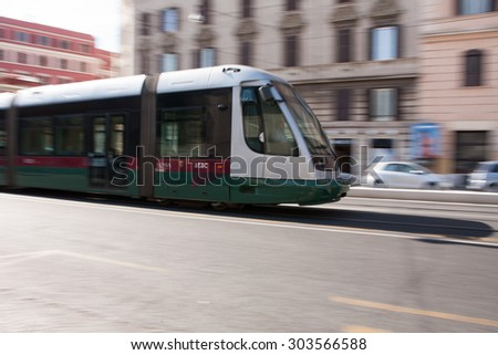 ROME, ITALY - MAY, 2015: Tram moving on the street of Rome.