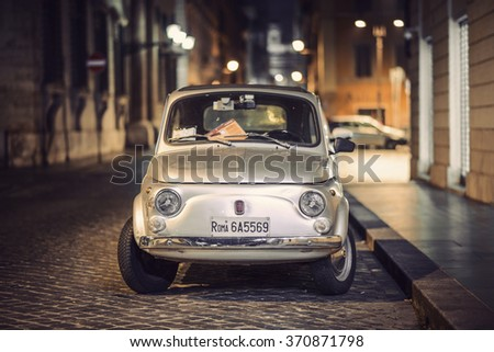 ROME, ITALY - NOVEMBER 15: A parked Fiat 500 in the streets of Rome on November 15, 2015 in Rome, Italy, Europe. The Fiat 500 Cinquecento is a famous Italian symbol.