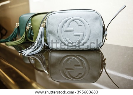 "ROME, ITALY - 19 NOVEMBER 2012: A row of Gucci 'Soho' bags bearing the interlocking ""G"" logo are displayed for sale inside a Gucci store."