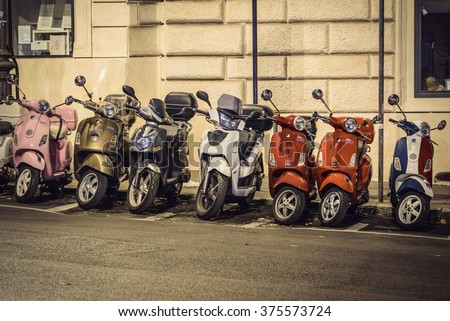ROME, ITALY - NOVEMBER 14: A row of Italian scooters Vespa in the streets of Rome on November 14, 2015 in Rome, Italy, Europe. Vespa is an Italian brand of scooter manufactured by Piaggio. - stock photo