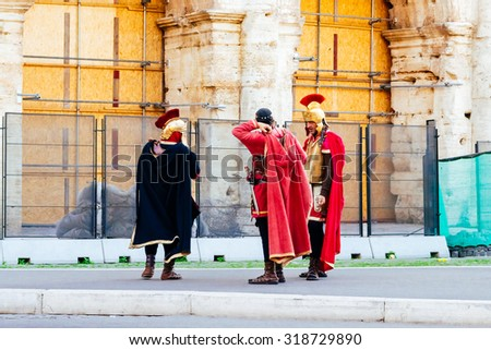 ROME, ITALY - OCTOBER 30: Entertainers dressed as Roman soldiers from the Roman Empire in streets of Rome, Italy on October 30, 2014. - stock photo