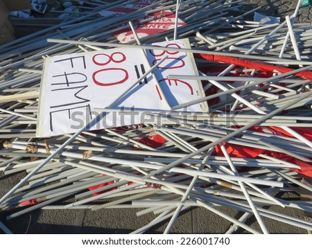 ROME, ITALY - OCTOBER 25, 2014: Flags of the workers of CGIL labor union abandoned after the protest in San Giovanni square - stock photo