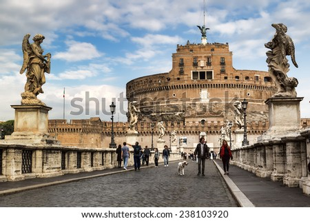 ROME, ITALY - OCTOBER 29, 2014: People on the bridge of Castel Sant'Angelo in Rome, Italy  - stock photo