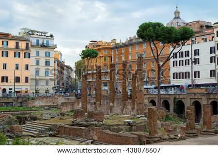 Rome, Italy - October 29, 2014: Ruins in Largo Argentina in Rome. Largo di Torre Argentina is a square in Rome that hosts four Republican Roman temples and the remains of Pompey's Theatre.