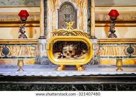 ROME, ITALY - OCTOBER 30: Skull of St Valentine is kept in the Greek-Catholic Church of Santa Maria in Cosmedin in Rome, Italy on October 30, 2014. - stock photo