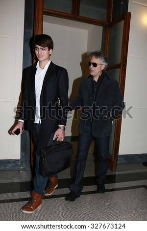 ROME, ITALY - 02 October 2013: The singer Andrea Bocelli with his son Amos Bocelli exit of the Auditorium RAI