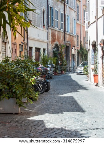 ROME, ITALY, on AUGUST 25, 2015. The picturesque narrow street in historical part of the city