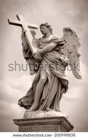 Rome, Italy. One of the angels at famous Ponte Sant' Angelo bridge. Baroque sculpture by Ercole Ferrata. Sepia tone - retro monochrome color style. - stock photo