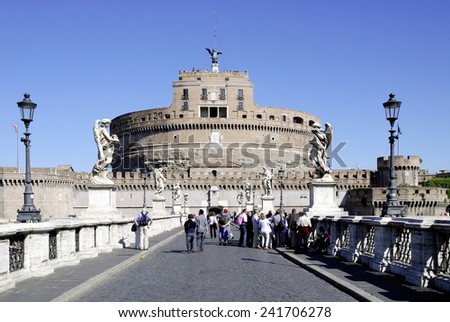 Rome, Italy - September 21, 2011: Angel castle with the Angel bridge at the Tiber in Rome with tourists. - stock photo