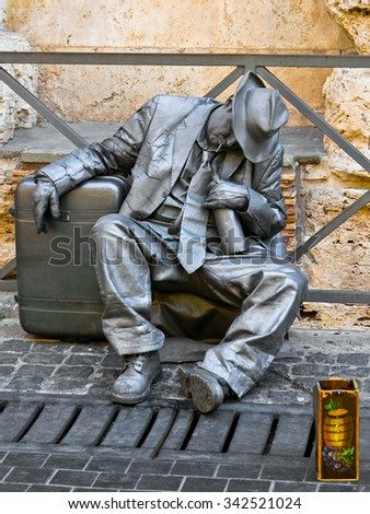 ROME, ITALY - SEPTEMBER 12 2012: Close-up of a street artist who performs on the streets.