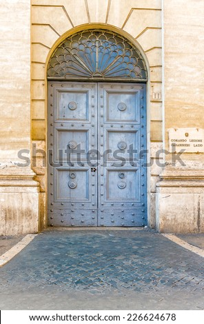 Rome, Italy - September 2, 2014: Old picturesque entrance doors to the public building in center of Rome
