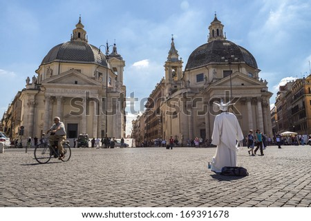 """ROME, ITALY - September 23 : People passing from Piazza del Popolo, by the """"twin"""" churches of Santa Maria in Montesanto and Santa Maria dei Miracoli on September 23, 2013 in Rome Italy. - stock photo"""