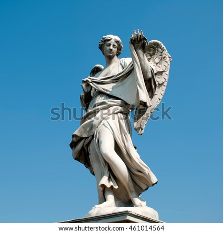 ROME, ITALY - SEPTEMBER 28 2009: The famous Ponte Sant'Angelo statues in the heart of Rome. The bridge is now pedestrian, and provides a photogenic vista of the Castel Sant'Angelo
