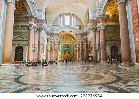 Rome, Italy - September 1, 2014: Tourists inside the  Basilica of Santa Maria Degli Angeli E Dei Martiri on September 1, 2014. - stock photo