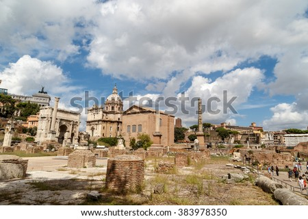 ROME, ITALY - SEPTEMBER 24, 2015 : View of archeological area of ancient Roman Forum in Rome, on cloudy blue sky background.