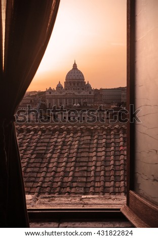 Rome, Italy: St. Peter's Basilica at sunset seen through a window.