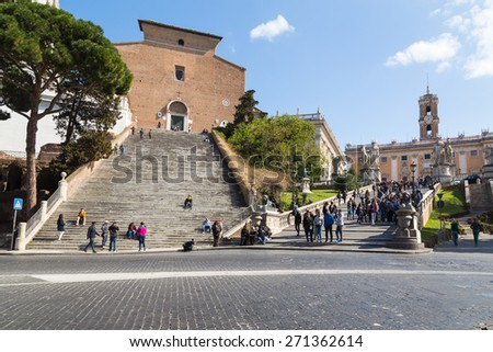 ROME, ITALY - 12TH MARCH 2015: Cordonata steps leading up to the Basilica di Santa Maria in Ara coeli and Capitoline Museums during the day. Large amounts of people can be seen. - stock photo