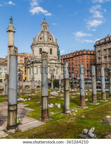 ROME, ITALY - 12TH MARCH 2015: Part of the Trajan's Forum (Foro Di Traiano) showing some of the ruins, Trajan's Column, Santissimo Nome di Maria al Foro Traiano Church. People can be seen by the ruins