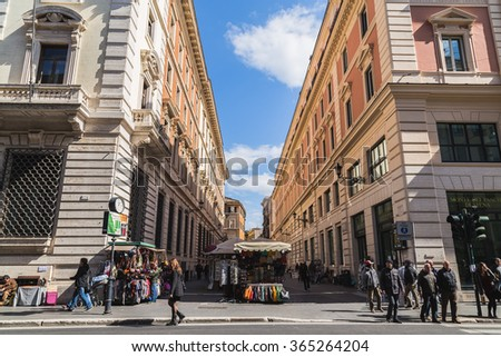 ROME, ITALY - 12TH MARCH 2015: Streets markets in Rome during the day. Lots of people can be seen. - stock photo