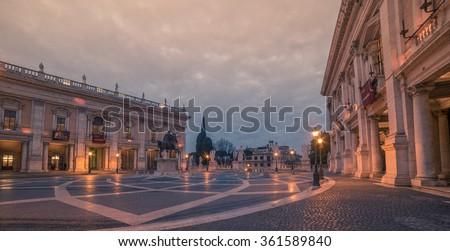 Rome, Italy: The Capitoline Hill, Latin: Collis Capitolinus, Italian: Campidoglio, in the sunrise. Capitolium square, Italian: Piazza del Campidoglio - stock photo