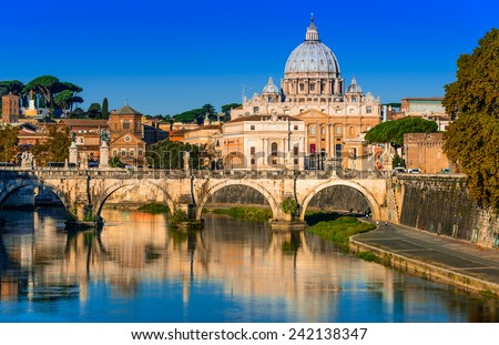 Rome, Italy. Vatican dome of San Pietro and Sant Angelo Bridge, over Tiber river.