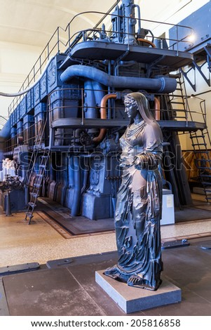 ROME - JULY 03: ancient statues in Centrale Montemartini on July 03, 2014 in Rome. Its an old electricity plant that houses 400 Roman statues that were previously exhibited in the Capitoline museums  - stock photo
