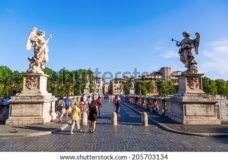 ROME - JULY 02: Ponte Sant Angelo and unidentified people on July 02, 2014 in Rome. The bridge was completed in 134 AD by Roman Emperor Hadrian, spanning the Tiber from city to Castel Sant Angelo. - stock photo
