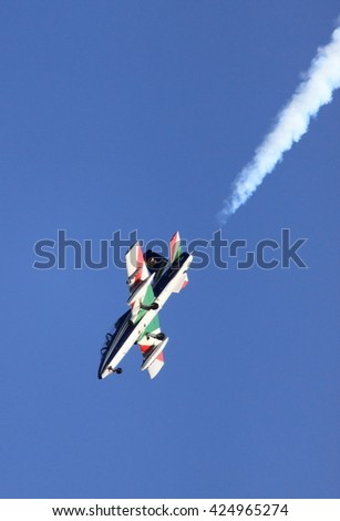 ROME - JUNE 28: A MB-339 of the italian acrobatic team Frecce Tricolori performs at the Rome International Air Show on June 28, 2014 in Rome, Italy - stock photo