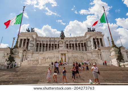ROME - JUNE 30: memorial Vittoriano with unidentified people on June 30, 2014 in Rome. This monumental memorial for king Vittorio Emanuele II with guards was erected by Giuseppe Sacconi 1885 - 1911.