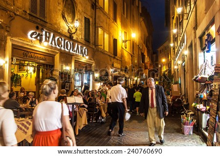 ROME - JUNE 24: People eat in street restaurants on June 24, 2014 in Rome, Italy. According to Euromonitor, Rome is the 3rd most visited city in Europe (5.5m international tourist arrivals 2009).