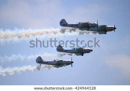 ROME - JUNE 28: The acrobatic team Yak Italia perform at the Rome International Air Show on June 28, 2014 in Rome, Italy - stock photo