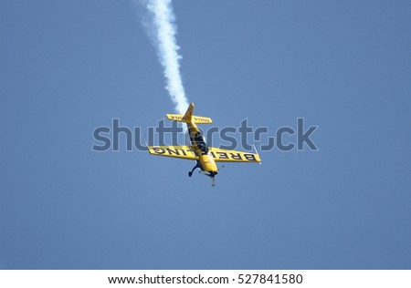 ROME - JUNE 3: The italian pilot Francesco Fornabaio performs on a Breitling Extra 300 airplane at the Rome International Air Show on June 3, 2012 in Rome, Italy