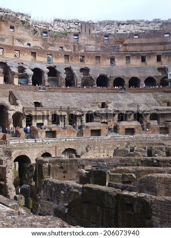 ROME - MAY 4: Coliseum interior facade on May 4, 2014 in Rome. The Colosseum or Coliseum (Flavian Amphitheatre) is an elliptical amphitheatre built of concrete and stone. The largest in the world. - stock photo