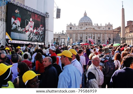 ROME - MAY 1: Crowd of pilgrims on Saint Peter's Square during the celebration for the John Paul II beatification on May 1,2011 in Rome - stock photo