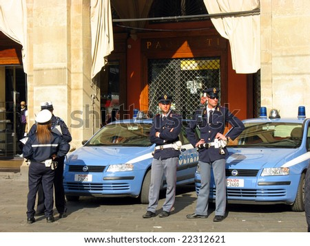 ROME - MAY 1: Italian police car and policemen on Labour May Day demonstration in Rome, May 1, 2008, Italy - stock photo