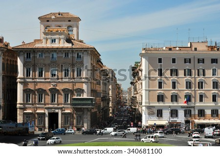 ROME - MAY 07: Piazza Venezia in Rome on May 07. 2015 in Italy - Piazza Venezia is the central hub of Rome, Italy, in which several thoroughfares intersect, including the Via dei Fori Imperiali. - stock photo