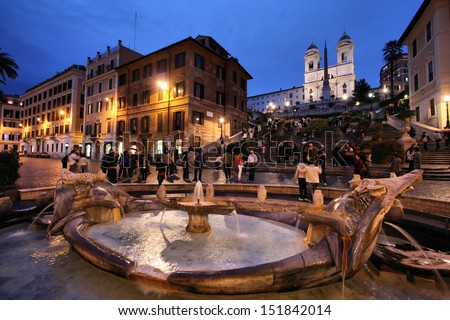 ROME - MAY 10: Tourists stroll on May 10, 2010 in Rome, Italy. Piazza di Spagna with its Spanish Steps is one of the most iconic city squares in the world and one of Italy's top tourism destinations. - stock photo