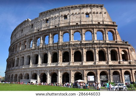 ROME - MAY 07: Tourists walk next to The Colosseum or Coliseum, also known as the Flavian Amphitheatre in Rome on May 07. 2015 in Italy.