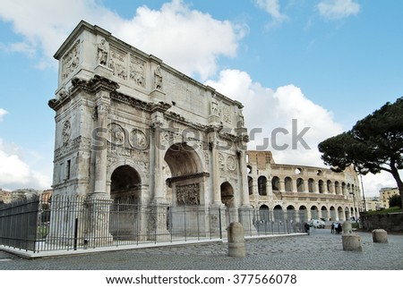 Rome monument Arch of Constantine and colosseum - stock photo