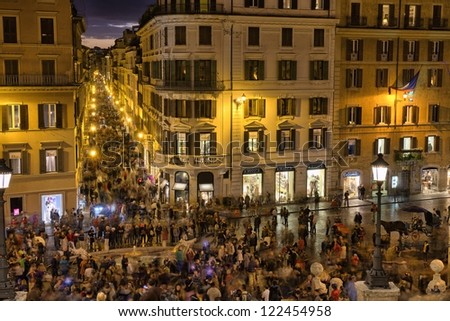 ROME - NOV 3: People walks in Piazza di Spagna and Spanish Steps, November 3, 2012 in Rome. Near 5 million people come to visit the city every year - stock photo