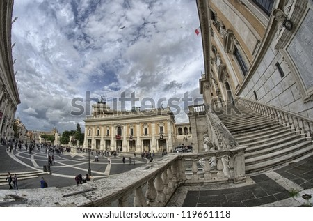 ROME - NOV 3: Tourists walk on November 3, 2012 in Rome, Italy. The square of Musei Capitolini is one of Italy's top tourism destinations. - stock photo