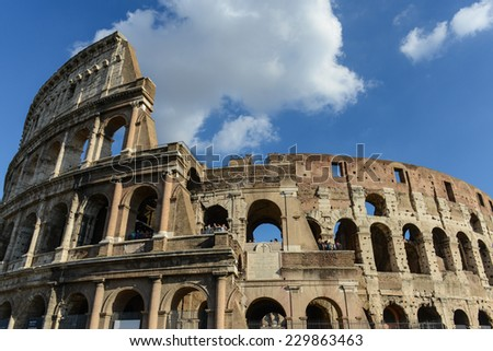 ROME - OCTOBER 18: Colosseum exterior on October 18, 2014 in Rome, Italy. The Colosseum is one of Rome's most popular tourist attractions with over 5 million visitors per year.