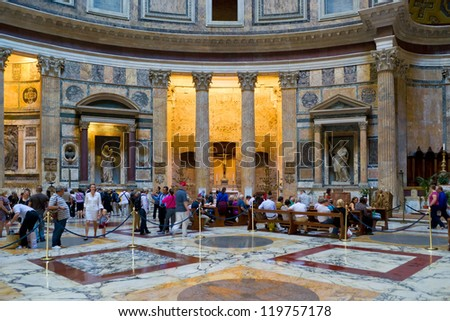 ROME - OCTOBER 2: Tourists visit in the pantheon on October 2, 2012 in Rome, Italy. Pantheon is a famous monument of ancient Roman culture, the temple of all the gods, built in the 2nd century.