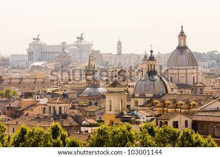 Rome overview with monument and several domes - stock photo