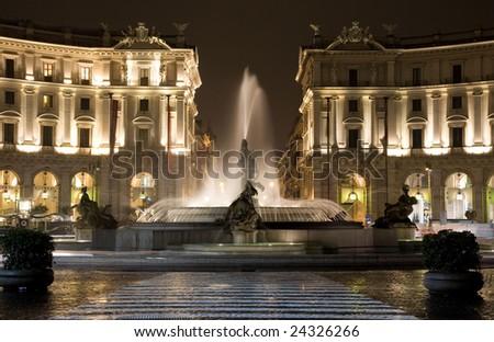 Rome, piazza della Repibblica at the night. Fountain of the Naiads. - stock photo