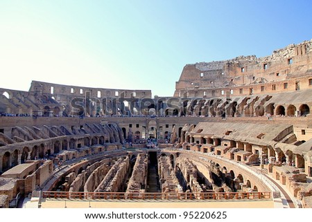 ROME - SEPTEMBER 17: The Colosseum on September 17, 2011 in Rome. The Colosseum is an elliptical arena in the centre of the city of Rome, Italy, the largest ever built in the Roman Empire. - stock photo