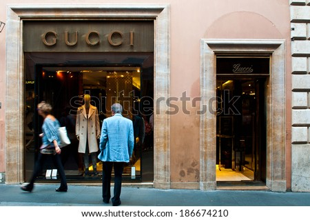 ROME - SEPTEMBER 18: unidentified man looking at Gucci show window at Via dei Condotti in Rome, Italy on September 18, 2013. As per Forbes 2013 list Gucci was ranked 38 most valuable brand. - stock photo