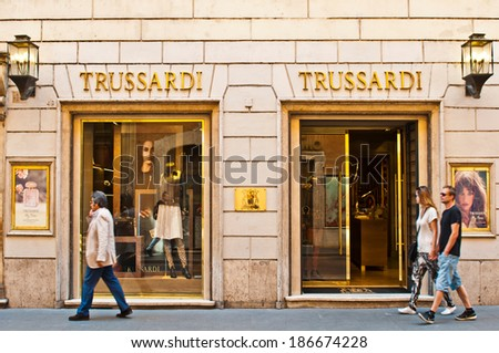 ROME - SEPTEMBER 18: unidentified people walking and looking at Trussardi store at Via dei Condotti in Rome, Italy on September 18, 2013. It is a luxury fashion brand made in Italy with +400 stores. - stock photo
