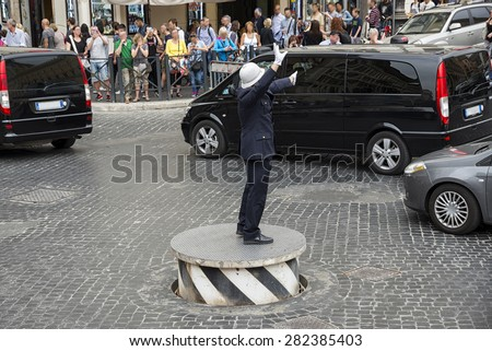 "Rome 05-15-2015: the Vigile Urbano called "" Pizzardone "" in piazza Venezia in Rome is an historical istitution. On his footboardit he has become one of the tourists attractions in the city"